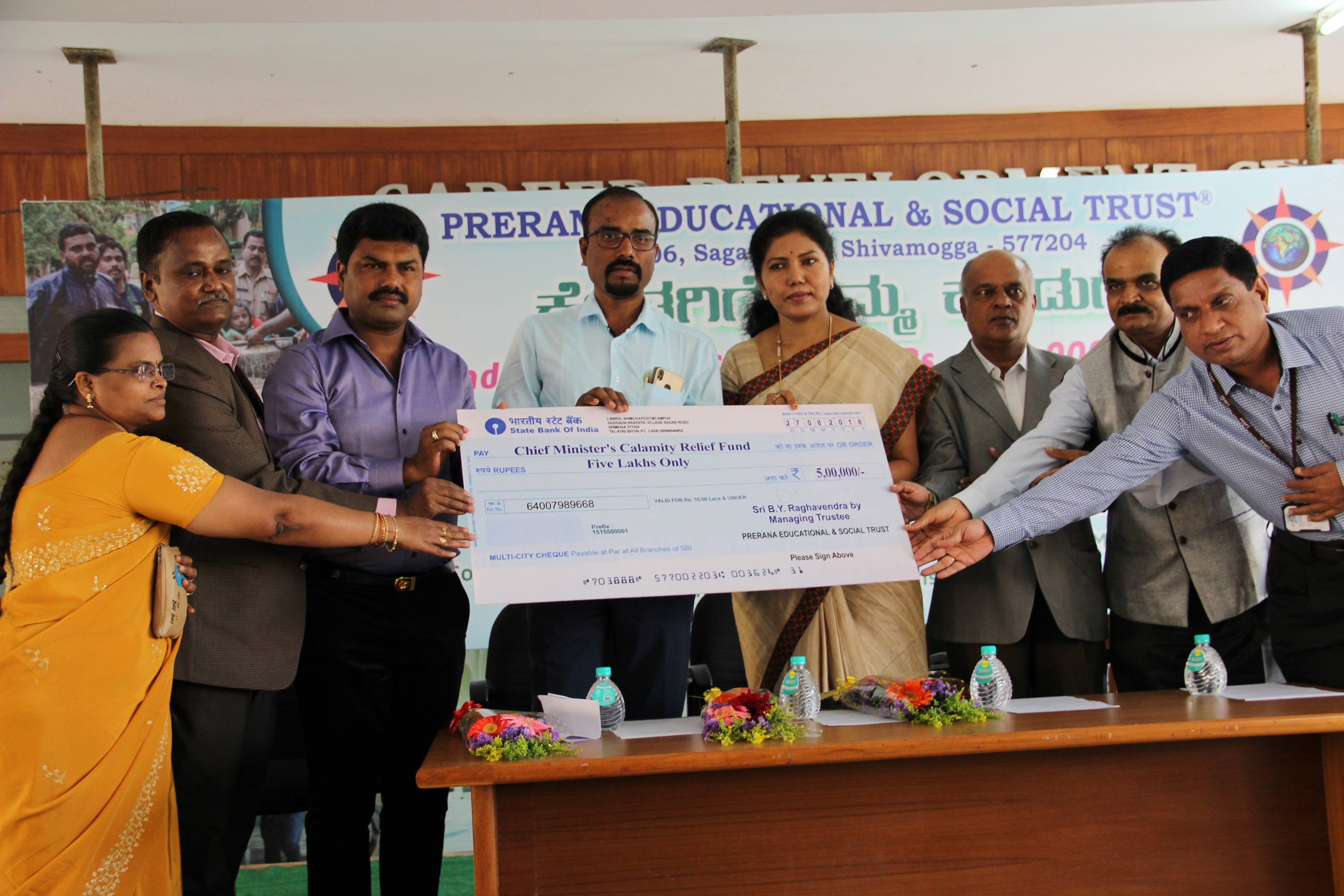 Kodagu Flood relief Fund from PES Trust Management,Staff and Students